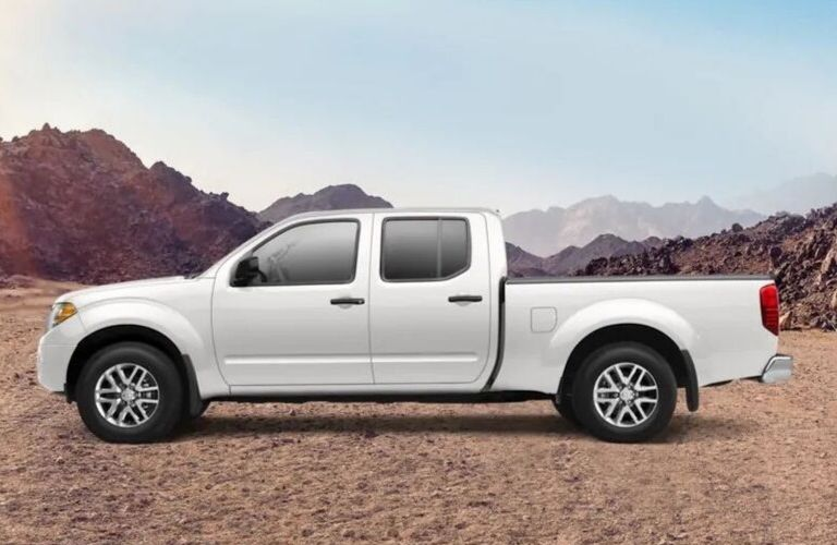 Exterior view of a white 2019 Nissan Frontier Crew Cab Long Bed