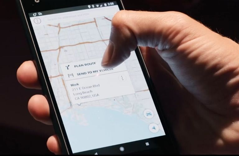 Image of someone using the NissanConnect convenience features on their smartphone