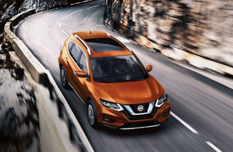 Exterior view of the front of an orange 2020 Nissan Rogue