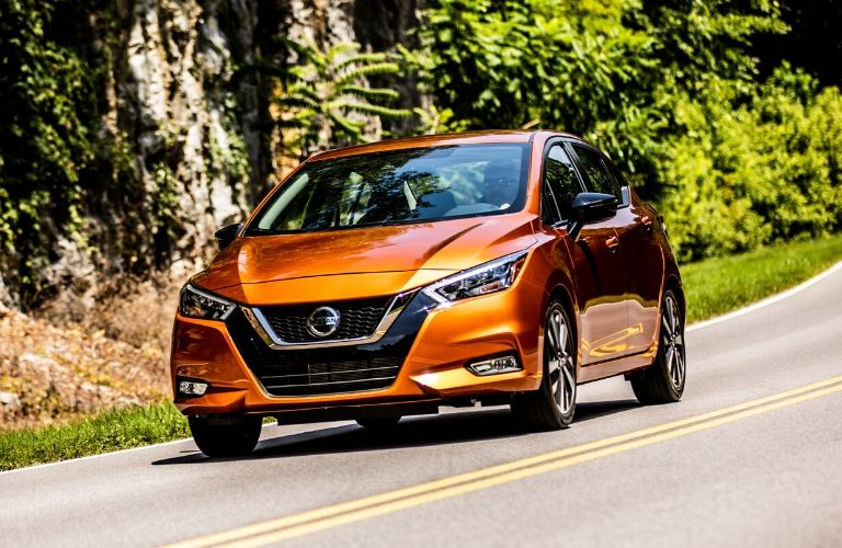 Exterior view of the front of an orange 2020 Nissan Versa