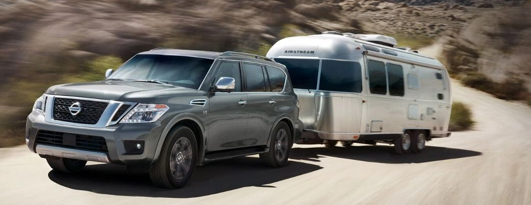 Exterior view of a gray 2020 Nissan Armada towing a travel trailer
