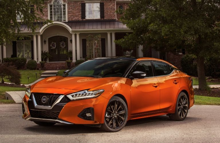 Exterior view of the front of an orange 2020 Nissan Maxima