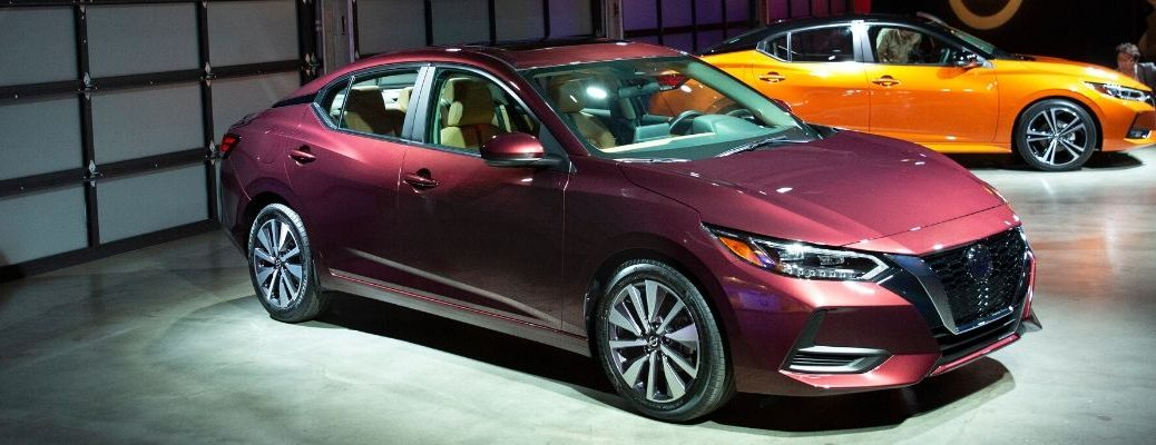Exterior view of the front of a maroon 2020 Nissan Sentra at the LA Auto Show