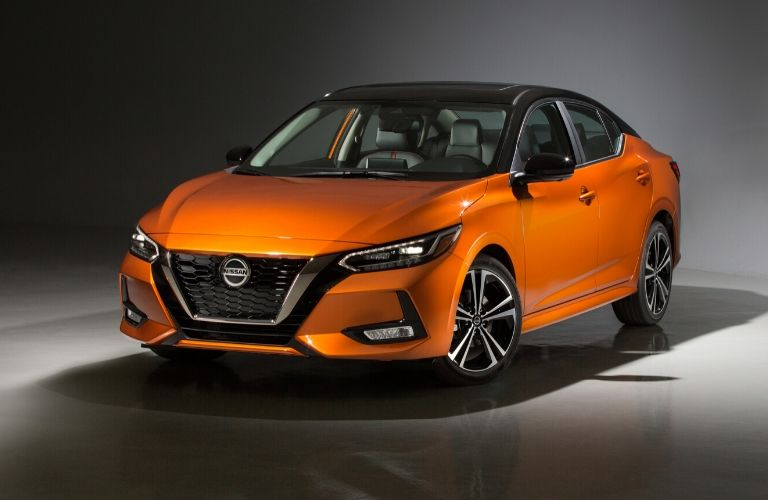 Exterior view of the front of the driver's side of an orange 2020 Nissan Sentra