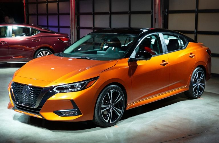 Exterior view of the front of an orange 2020 Nissan Sentra at the LA Auto Show