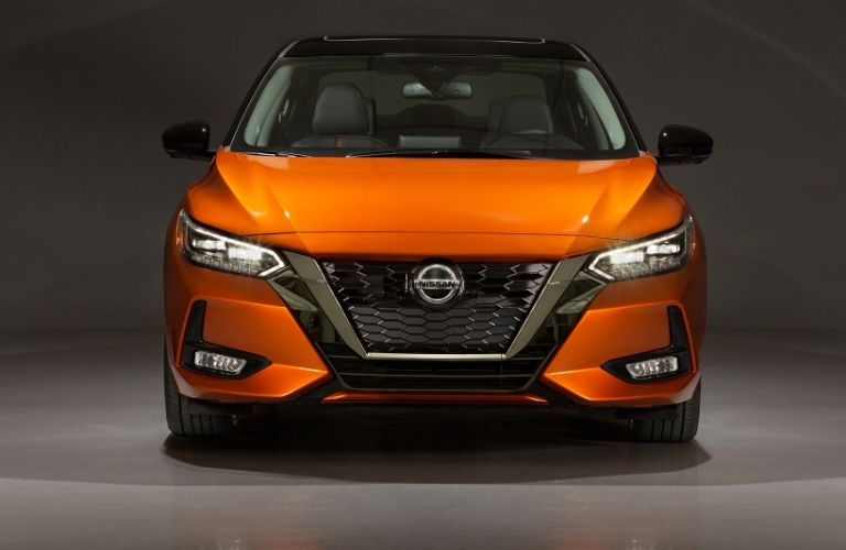 Exterior view of the front of an orange 2020 Nissan Sentra