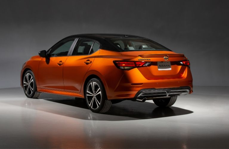 Exterior view of the rear of the driver's side of an orange 2020 Nissan Sentra