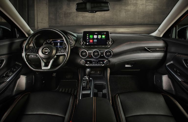 Interior view of the front seating area inside a 2020 Nissan Sentra