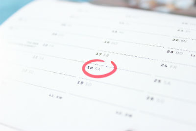 large calendar with 18 circled in red marker