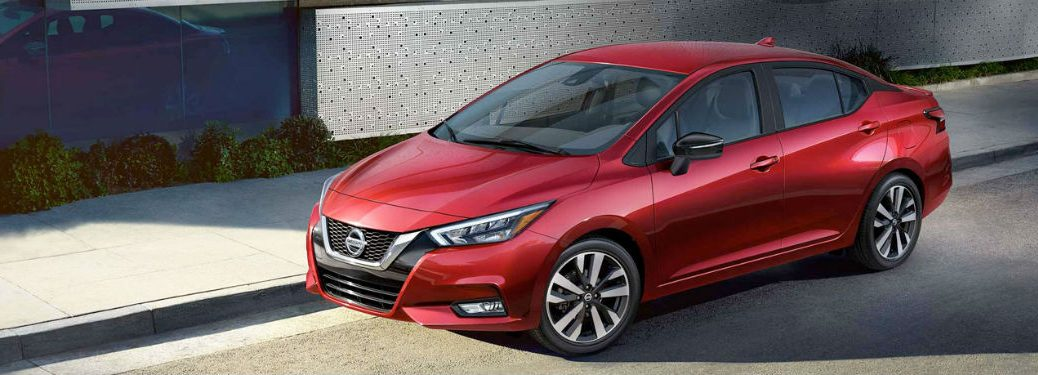 2020 Nissan Versa red exterior front fascia driver side parked