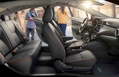 2020 Nissan Versa interior side view of front and second row seats driver side doors open