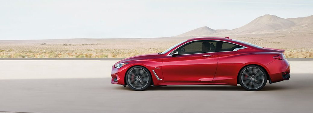 2020 Infiniti Q60 red exterior driver side desert in background