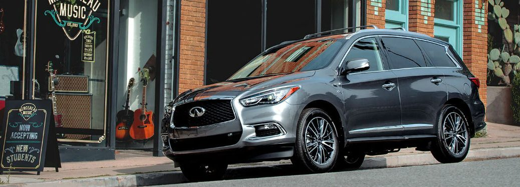 2020 INFINITI QX60 silver exterior front fascia driver side parked in front of music store