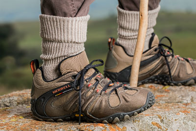 close up of mans brown socks and hiking boots