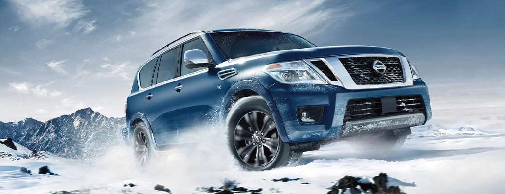 2020 Nissan Armada front passenger side driving in snow