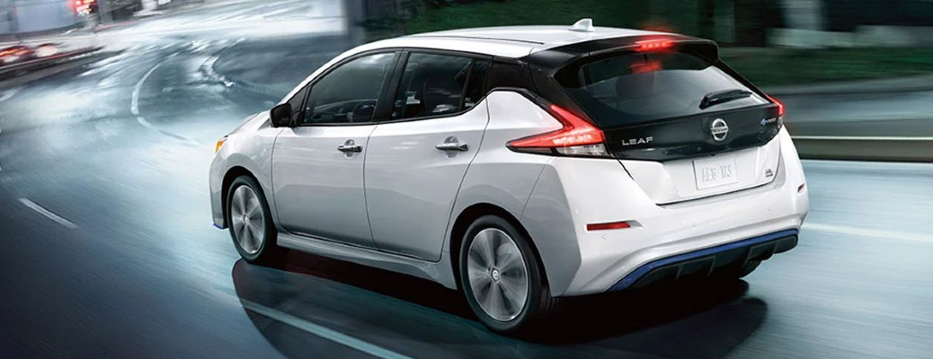 2020 Nissan Leaf white exterior rear driver side driving