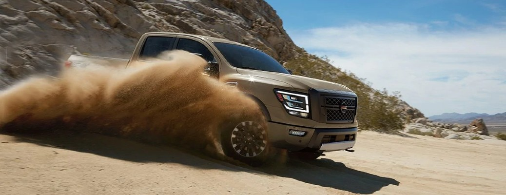 2020 Nissan Titan driving through sand