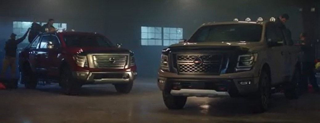 Two 2020 Nissan Titan trucks parked in a garage