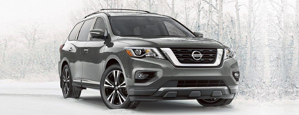 2020 Nissan Pathfinder grey exterior front passenger side parked in snow covered forest