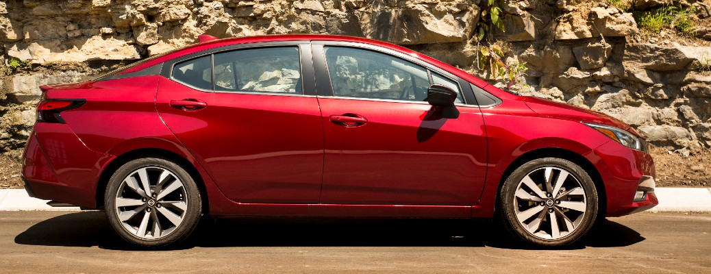 Side view of red 2020 Nissan Versa