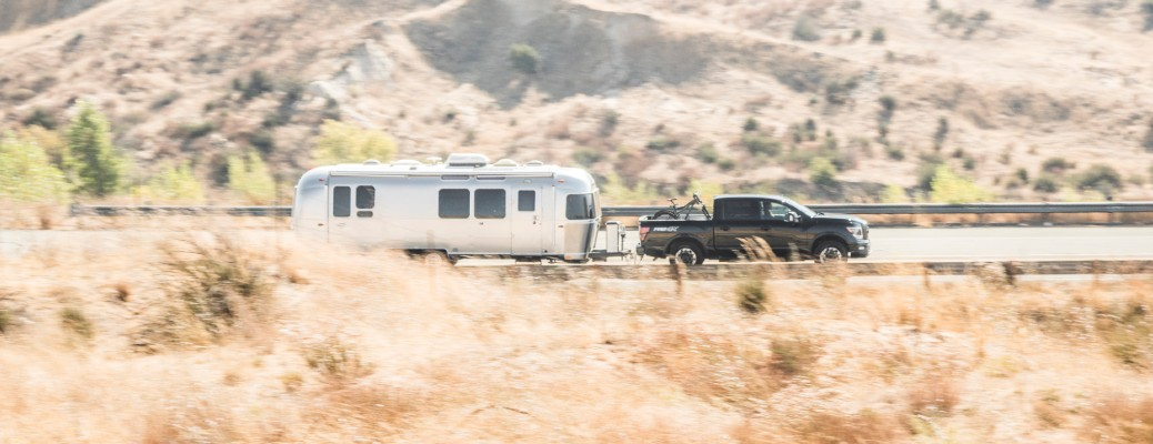 Black 2021 Nissan TITAN towing an Airstream trailer