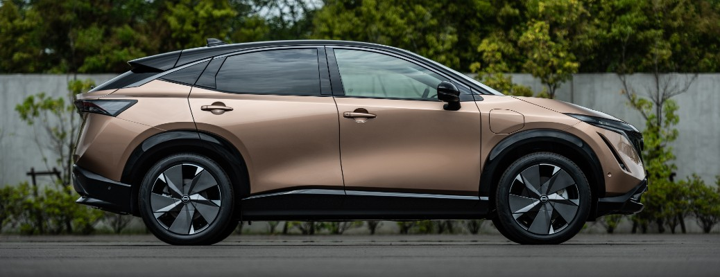 Side view of copper Nissan Ariya