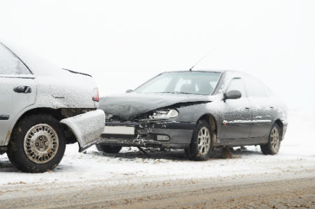 car accident cause by snowy and icy roads