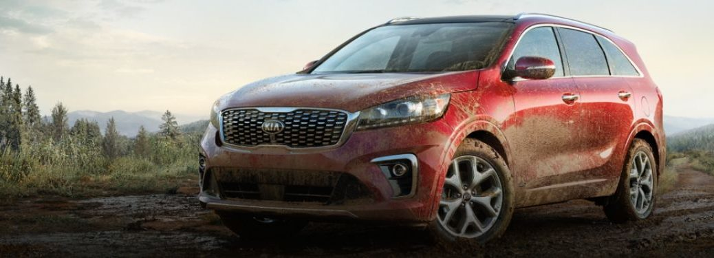 Red 2020 Kia Sorento exterior with mud from front driver side