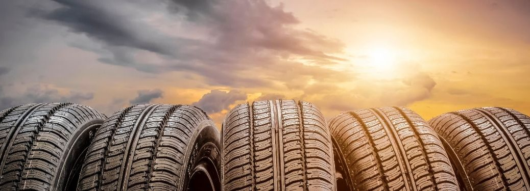 Five tires in front of sunset