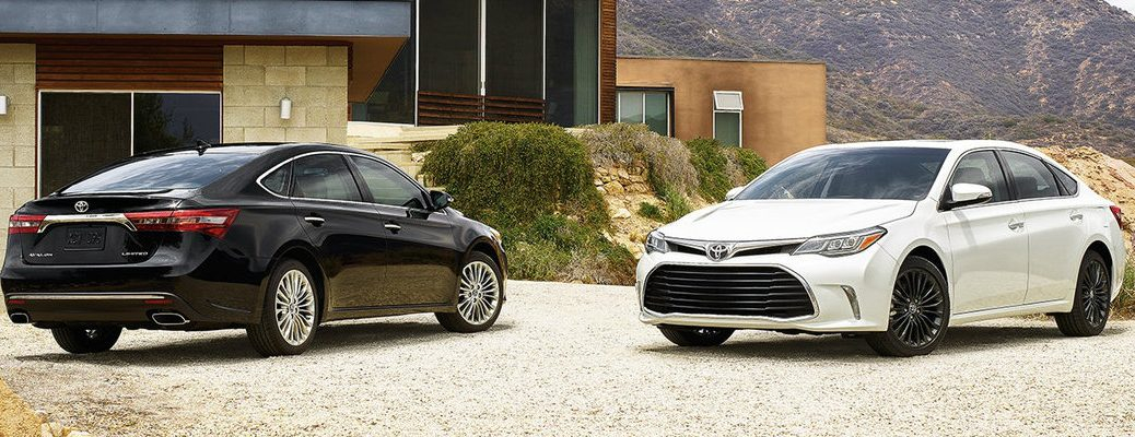 Two 2018 Toyota Avalon models parked in front of modern house