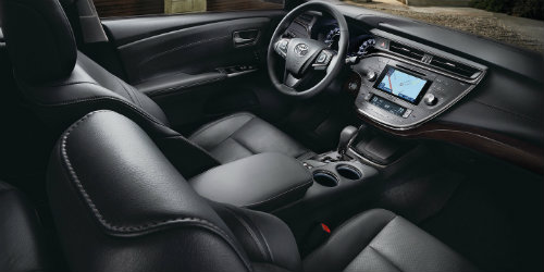 2018 Toyota Avalon leather seating with prominent dashboard and touchscreen