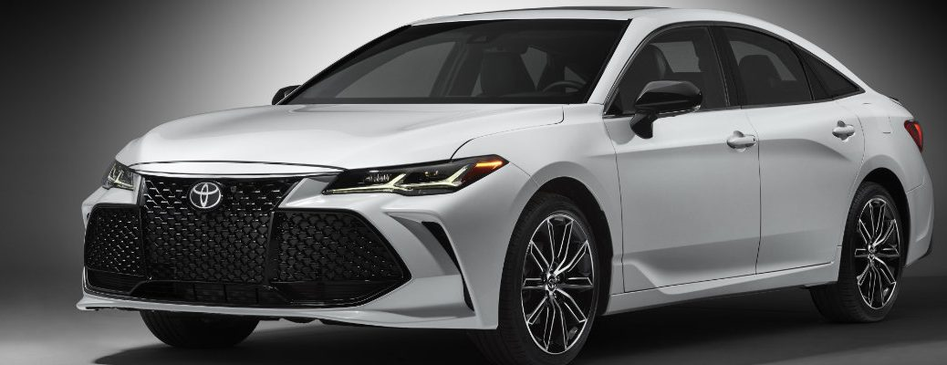 Profile shot of white and black 2019 Toyota Avalon on gray background