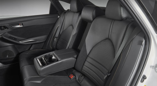 Back row of seating in 2019 Toyota Avalon with center fold-down armrest prominently shown