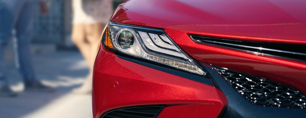 Isolated shot of 2018 Toyota Camry XSE headlight and grille