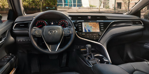 2018 Toyota Camry interior with touchscreen interface prominent