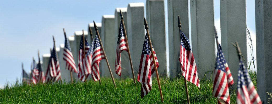 American flags decorating gravestones in Arlington National Cemetery to commemorate Memorial Day
