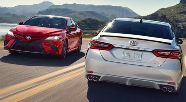 Two 2019 Toyota Camry models driving on mountainous road