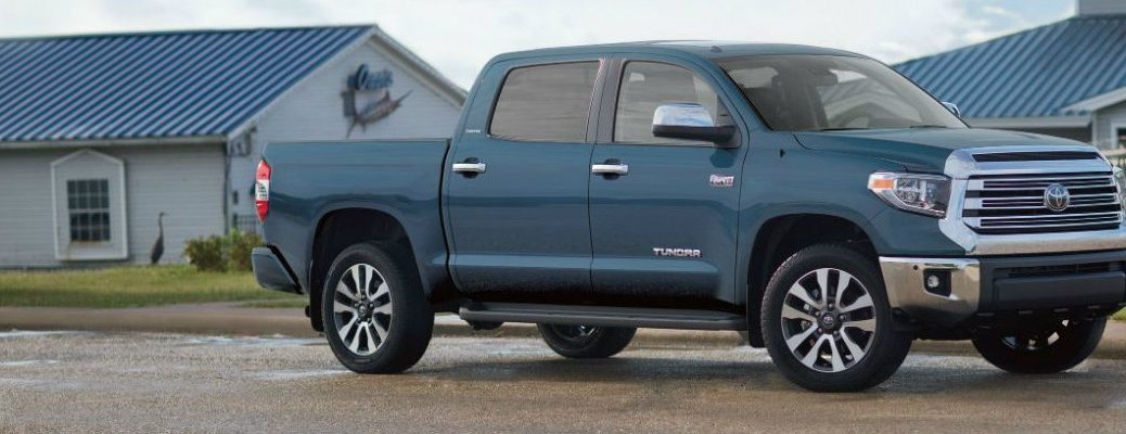 Profile view of blue 2019 Toyota Tundra parked in front of garage