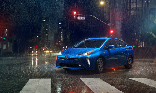 2019 Toyota Prius driving on rainy road at night