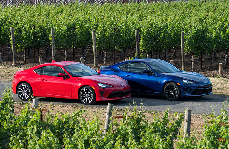 Two 2019 Toyota 86 models parked in corn field