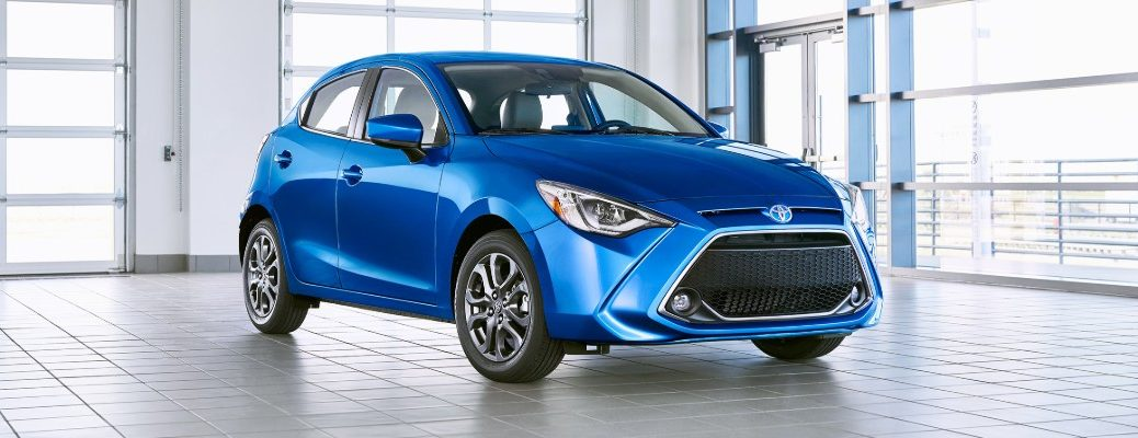 Front and side views of 2020 Toyota Yaris Hatchback parked in warehouse