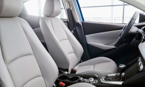 Front two seats and steering wheel inside 2020 Toyota Yaris Hatchback