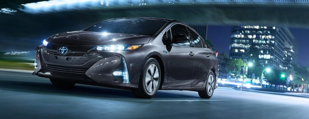 Toyota Prius Prime driving on dark city road