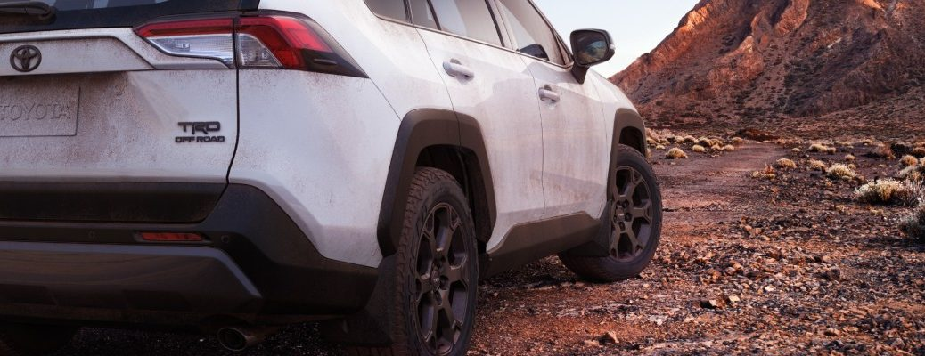 Taillights and passenger side wheels of white 2020 Toyota RAV4 TRD Off-Road SUV