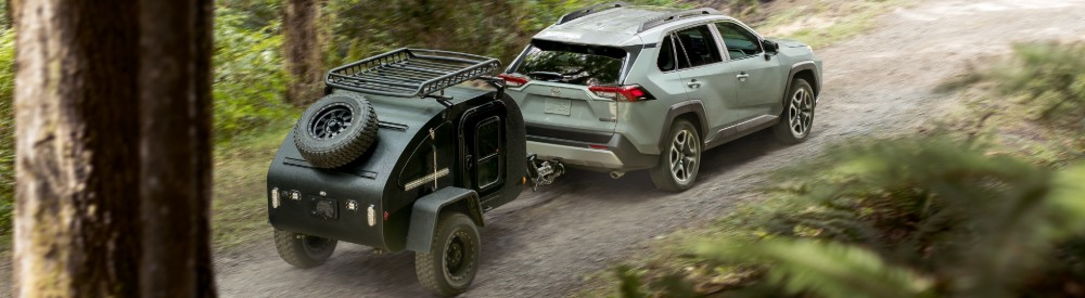 Overhead view of 2019 RAV4 Hybrid driving on wooded trail