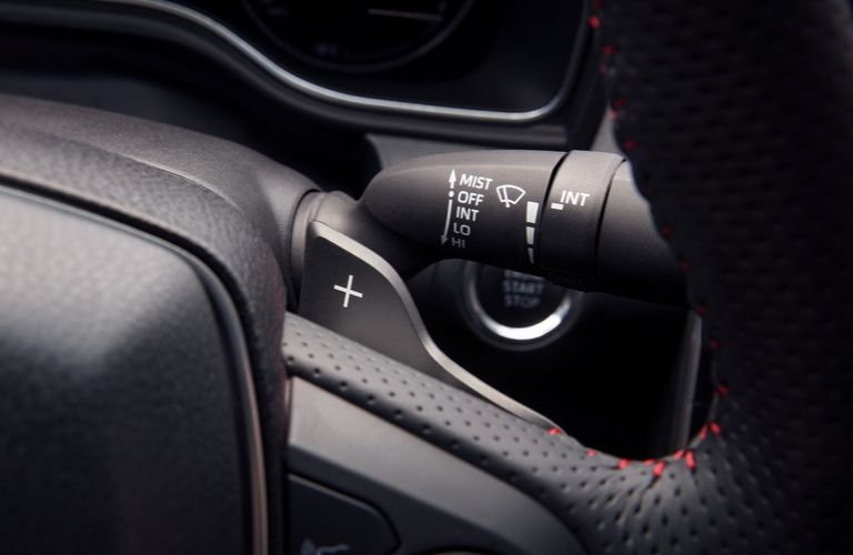 Closeup view of the available paddle shifters inside a 2020 Toyota Avalon