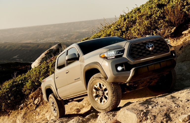Exterior view of the front of a beige 2020 Toyota Tacoma