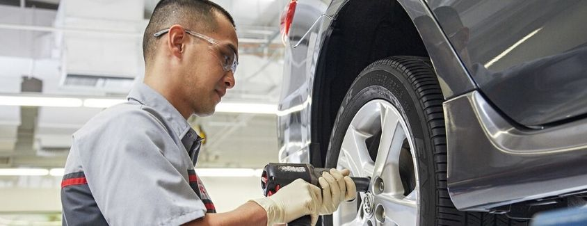 Image of a Toyota service technician replacing the tires on a Toyota vehicle