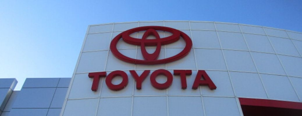 Image of a Toyota logo on the side of a Toyota dealership