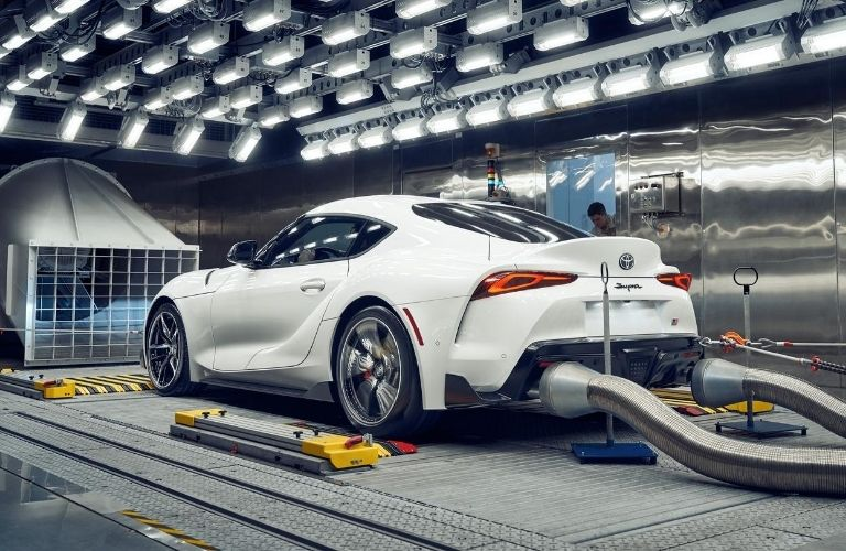 Exterior view of white 2021 Toyota Supra having performance tests conducted
